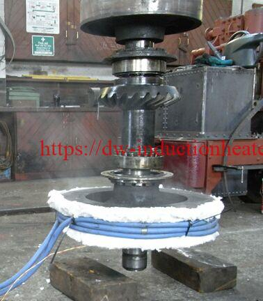 Induction shrink fitting shaft machine